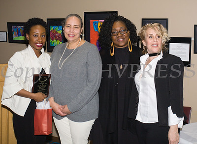Tashae Smith receives her award from Ramona Burton, Malinda Ware and Rosina Tezgeldi during the City of Newburgh Human Rights Commission sponsored Second Annual Black Pioneers of Newburgh at the Newburgh Free Library on Saturday, February 18, 2017. Hudson Valley Press/CHUCK STEWART, JR.