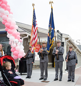 A child sings the National Anthem as the New York State Troopers Color Guard presents arms, prior to thousands of people, including cancer survivors, their families and businesses, participate in the annual American Cancer Society Making Strides Against Breast Cancer walk at Woodbury Common Premium Outlets in Central Valley, NY on Sunday, October 15, 2017. Hudson Valley Press/CHUCK STEWART, JR.