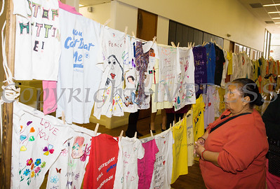 People look at the Clothesline Project, which is a powerful visual display of T-shirts bearing the stories of victims and survivors of domestic violence. They were on display as Safe Homes of Orange County kicked off Domestic Violence Awareness Month in Newburgh, NY on Monday, October 2, 2017. Hudson Valley Press/CHUCK STEWART, JR.