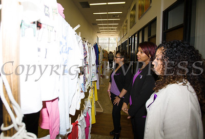 Jessica Ortiz, Sarita Green and Rachel Robinson look at the Clothesline Project, a powerful visual display of T-shirts bearing the stories of victims and survivors of domestic violence. They were on display as Safe Homes of Orange County kicked off Domestic Violence Awareness Month in Newburgh, NY on Monday, October 2, 2017. Hudson Valley Press/CHUCK STEWART, JR.