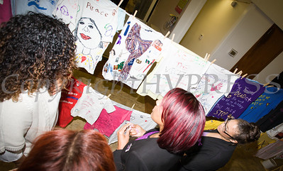 People look at the Clothesline Project, a powerful visual display of T-shirts bearing the stories of victims and survivors of domestic violence. They were on display as Safe Homes of Orange County kicked off Domestic Violence Awareness Month in Newburgh, NY on Monday, October 2, 2017. Hudson Valley Press/CHUCK STEWART, JR.