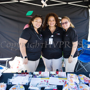 Julia Puma, Milagros Torres and Juana Leandry-Torres of MVP Health Care hand out information during the community baby shower on Saturday, September 23 for expectant mothers and parents of babies. Hudson Valley Press/CHUCK STEWART, JR.