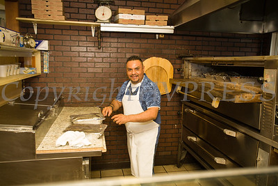 Owner Manny Marzeza prepares food in the kitchen prior to a ribbon cutting ceremony to celebrate the grand opening of Francesca's Pizzeria & Restaurant in Montgomery on October 16, 2017. Hudson Valley Press/CHUCK STEWART, JR.