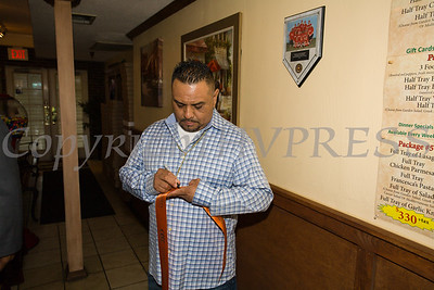 Owner Manny Marzeza, signs the ribbon that was cut during the ribbon cutting ceremony to celebrate the grand opening of Francesca's Pizzeria & Restaurant in Montgomery on October 16, 2017. Hudson Valley Press/CHUCK STEWART, JR.