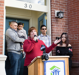 Habitat for Humanity of Greater Newburgh Executive Director Cathy Collins offers remarks as Habitat dedicated its 90th home on Friday, December 1, 2017. Hudson Valley Press/CHUCK STEWART, JR.