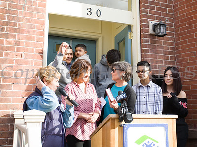 Family Advocate Volunteer Rita Ponessa presents a Bible to Viridiana as Habitat for Humanity of Greater Newburgh dedicated its 90th home on Friday, December 1, 2017. Hudson Valley Press/CHUCK STEWART, JR.