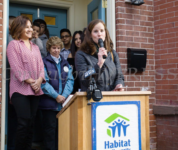 Habitat Newburgh Board of Directors Treasurer Martine Najork offers remarks as Habitat for Humanity of Greater Newburgh dedicated its 90th home on Friday, December 1, 2017. Hudson Valley Press/CHUCK STEWART, JR.