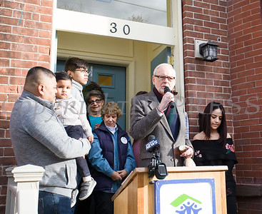 The Rev. Dr. Deke Spierling, Habitat Newburgh Board President, blesses the house as Habitat for Humanity of Greater Newburgh dedicated its 90th home on Friday, December 1, 2017. Hudson Valley Press/CHUCK STEWART, JR.