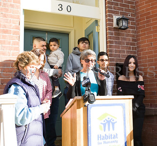 Family Advocate Volunteer Rita Ponessa offers reflections as Habitat for Humanity of Greater Newburgh dedicated its 90th home on Friday, December 1, 2017. Hudson Valley Press/CHUCK STEWART, JR.