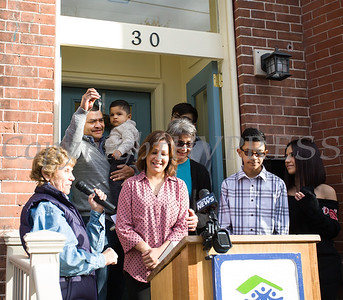 Family Advocate Volunteer Karen Adamson presents the keys to Juan as Habitat for Humanity of Greater Newburgh dedicated its 90th home on Friday, December 1, 2017. Hudson Valley Press/CHUCK STEWART, JR.