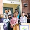 Family Advocate Volunteer Karen Adamson presents the keys to Juan as Habitat for Humanity of Greater Newburgh dedicated its 90th home on Friday, December 1, 2017. Hudson Valley Press/CHUCK STEWART, JR.
