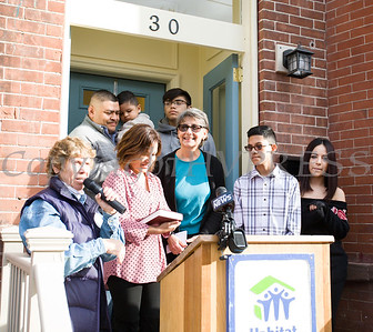 Family Advocate Volunteer Karen Adamson offers remarks after the family was presented with a Bible as Habitat for Humanity of Greater Newburgh dedicated its 90th home on Friday, December 1, 2017. Hudson Valley Press/CHUCK STEWART, JR.