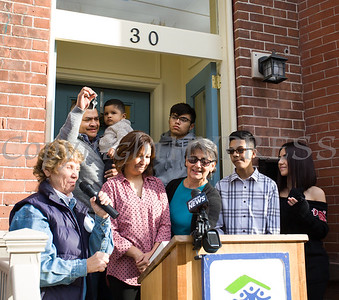 Family Advocate Volunteer Karen Adamson offers remarks after presenting the keys to Juan as Habitat for Humanity of Greater Newburgh dedicated its 90th home on Friday, December 1, 2017. Hudson Valley Press/CHUCK STEWART, JR.