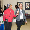 Ozie Williams hands the mic to Lena Ducasse Richardson of United Healthcare as the Poughkeepsie Healthy Black and Latino Coalition celebrated Black History Month with a Healthy Living Expo at the Catherine Street Community Center in Poughkeepsie, NY on Saturday, February 25, 2017. Hudson Valley Press/CHUCK STEWART, JR.