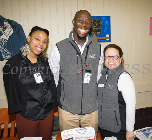 Shari Cassase, Christopher Kinlow and Juana Leandry-Torres of MVP Healthcare hand out literature as the Poughkeepsie Healthy Black and Latino Coalition celebrated Black History Month with a Healthy Living Expo at the Catherine Street Community Center in Poughkeepsie, NY on Saturday, February 25, 2017. Hudson Valley Press/CHUCK STEWART, JR.