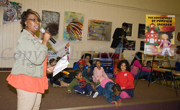 Glenda Faison-Crawford reads her book to children as the Poughkeepsie Healthy Black and Latino Coalition celebrated Black History Month with a Healthy Living Expo at the Catherine Street Community Center in Poughkeepsie, NY on Saturday, February 25, 2017. Hudson Valley Press/CHUCK STEWART, JR.