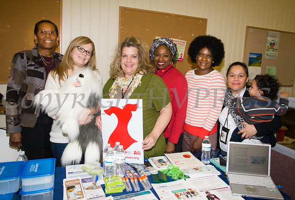 """Mashariki Okbar, Jennifer Minckler, RN, (holding """"Harry"""" the dog, Jacqueline Whiteley, RN, Ozie Williams, Joyce Maranga, RN, and Gabriela Owen of Dutchess County Department of Behavioral & Community health were on hand answering questions and handing out literature as the Poughkeepsie Healthy Black and Latino Coalition celebrated Black History Month with a Healthy Living Expo at the Catherine Street Community Center in Poughkeepsie, NY on Saturday, February 25, 2017. Hudson Valley Press/CHUCK STEWART, JR."""
