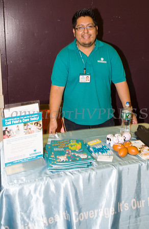 Jorge Huincho of Fidelis Care hands out literature as the Poughkeepsie Healthy Black and Latino Coalition celebrated Black History Month with a Healthy Living Expo at the Catherine Street Community Center in Poughkeepsie, NY on Saturday, February 25, 2017. Hudson Valley Press/CHUCK STEWART, JR.