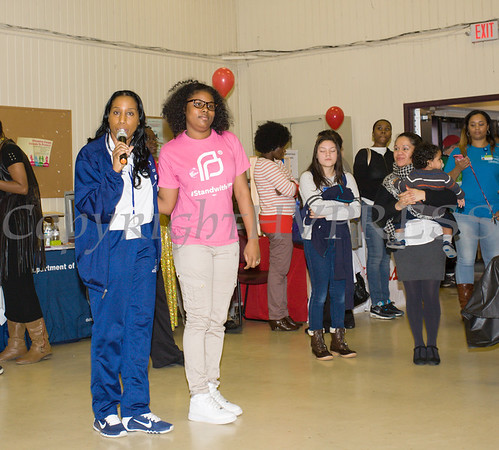 Poughkeepsie City School District Superintendent Dr. Nicole Williams (with Poughkeepsie Scholar Denzenai) offers remarks as the Poughkeepsie Healthy Black and Latino Coalition celebrated Black History Month with a Healthy Living Expo at the Catherine Street Community Center in Poughkeepsie, NY on Saturday, February 25, 2017. Hudson Valley Press/CHUCK STEWART, JR.