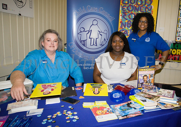 Nancey Owen, Brittany Tallegrand and Stacey Rosborough of the Child Care Council of Dutchess County hand out information as the Poughkeepsie Healthy Black and Latino Coalition celebrated Black History Month with a Healthy Living Expo at the Catherine Street Community Center in Poughkeepsie, NY on Saturday, February 25, 2017. Hudson Valley Press/CHUCK STEWART, JR.
