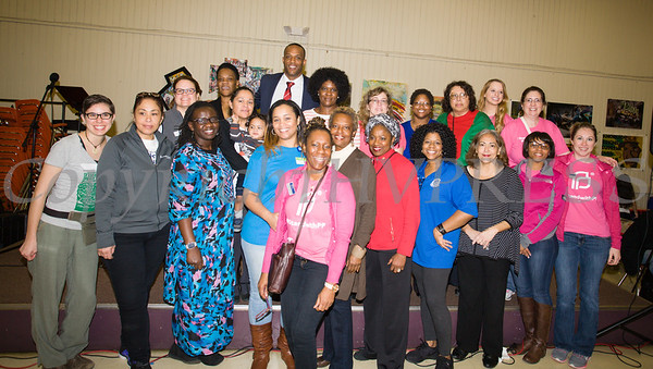 Members of the Poughkeepsie Healthy Black and Latino Coalition pose for a group photo as they celebrated Black History Month with a Healthy Living Expo at the Catherine Street Community Center in Poughkeepsie, NY on Saturday, February 25, 2017. Hudson Valley Press/CHUCK STEWART, JR.