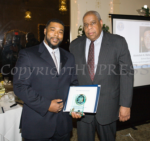 Honoree Addullah N. Rahaman II receives his award from OC Human Rights Commission Chair Fred Cook during the 22nd Annual Orange County Human Rights Commission Awards Dinner held on Wednesday, April 19 at Kuhl's Highland House in Middletown. Hudson Press/CHUCK STEWART, JR.