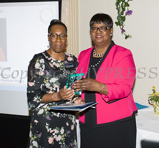 Honoree Lana Williams-Scott receives her award from Patricia Claiborne during the 22nd Annual Orange County Human Rights Commission Awards Dinner held on Wednesday, April 19 at Kuhl's Highland House in Middletown. Hudson Press/CHUCK STEWART, JR.