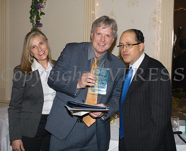 Honoree Christopher D. Watkins, Esq. (center) receives his award from OC Human Rights Commissioners Nadia Allen and Nolly Climes during the 22nd Annual Orange County Human Rights Commission Awards Dinner held on Wednesday, April 19 at Kuhl's Highland House in Middletown. Hudson Press/CHUCK STEWART, JR.