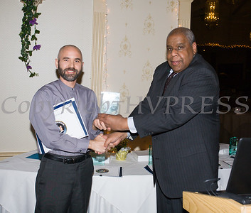 Honoree Rev. Chris J. Antal receives his award from OC Human Rights Commission Chair Fred Cook during the 22nd Annual Orange County Human Rights Commission Awards Dinner held on Wednesday, April 19 at Kuhl's Highland House in Middletown. Hudson Press/CHUCK STEWART, JR.