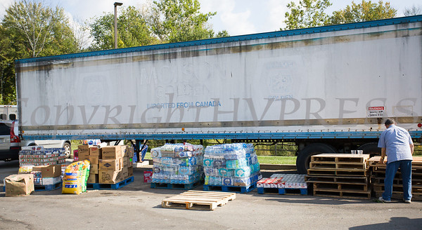 On Monday, September 25, volunteers at Cilantro's in New Windsor, NY organized donated items onto pallets, before a fork lift places them into a wating tractor trailer, which will take the shipment to a Jet Blue plane heading to Puerto Rico to help those affected by Hurricane Maria. Hudson Valley Press/CHUCK STEWART, JR.