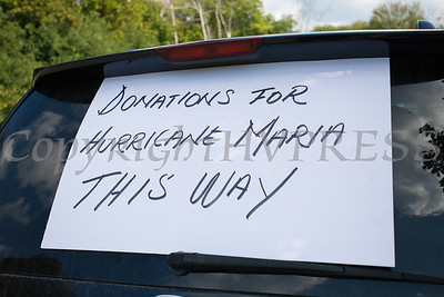 A sign on a car lets people know they are in the right place to drop off their Hurricane Maria donations at Cilantro's in New Windsor, NY on Monday, September 25, 2017. Hudson Valley Press/CHUCK STEWART, JR.