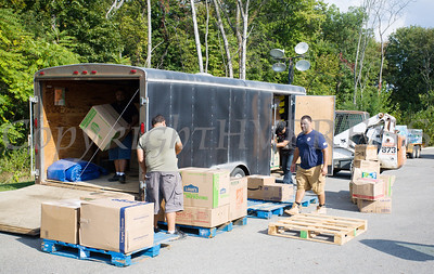 On Monday, September 25, volunteers at Cilantro's in New Windsor, NY unload a small trailer with boxed items, to place them on pallets, before a fork lift places them into a wating tractor trailer, which will take the shipment to a Jet Blue plane heading to Puerto Rico to help those affected by Hurricane Maria. Hudson Valley Press/CHUCK STEWART, JR.