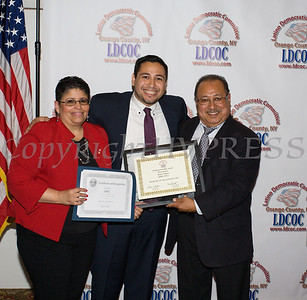 Sonia Ayala and Kevindaryan Lujan present Rene Campos with the Entrepreneurship Award during the Latino Democratic Committee of Orange County Fourteenth Annual Fall Dinner Dance at Cafe Internationale in Newburgh, NY on Saturday, October 14, 2017. Hudson Valley Press/CHUCK STEWART, JR.
