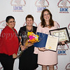 Sonia Ayala and Diana Campos present Annette Marzan with the Leadership Award during the Latino Democratic Committee of Orange County Fourteenth Annual Fall Dinner Dance at Cafe Internationale in Newburgh, NY on Saturday, October 14, 2017. Hudson Valley Press/CHUCK STEWART, JR.