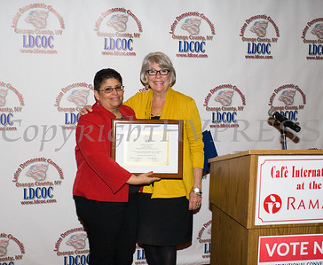 Sonia Ayala presents Ruth-Ellen Blodgett, President & CEO of Planned Parenthood Mid-Hudson Valley with an award during the Latino Democratic Committee of Orange County Fourteenth Annual Fall Dinner Dance at Cafe Internationale in Newburgh, NY on Saturday, October 14, 2017. Hudson Valley Press/CHUCK STEWART, JR.