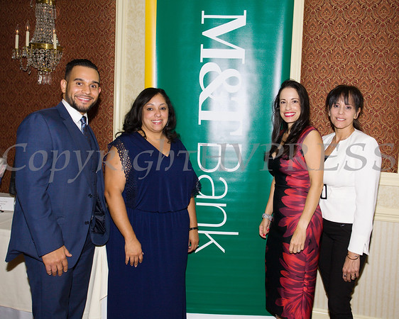 Representing M&T Bank are Carlos Alicea, Jr.,  Cynthia Santos, Gisela Gomez and Maribel Matos at Latinos Unidos of the Hudson Valley 12th Annual Hispanic Heritage Cultural Celebration at Anthony's Pier 9 in New Windsor, NY on Friday, October 13, 2017. Hudson Valley Press/CHUCK STEWART, JR.