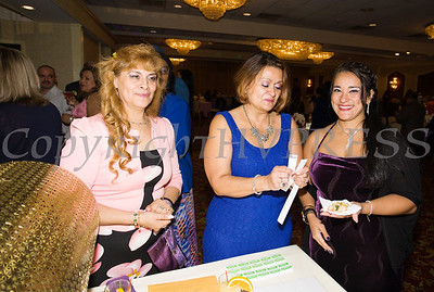 Maria Chavarria and Olga Hernandez sell raffle tickets during Latinos Unidos of the Hudson Valley 12th Annual Hispanic Heritage Cultural Celebration at Anthony's Pier 9 in New Windsor, NY on Friday, October 13, 2017. Hudson Valley Press/CHUCK STEWART, JR.