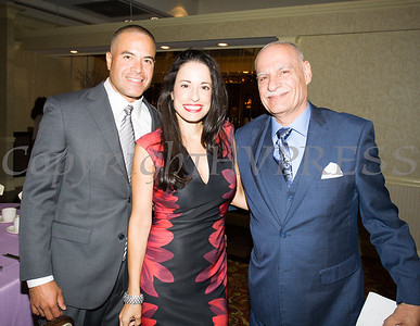David and Gisela Gomez are joined by Latinos Unidos of the Hudson Valley President Peter Gonzalez during the organizations 12th Annual Hispanic Heritage Cultural Celebration at Anthony's Pier 9 in New Windsor, NY on Friday, October 13, 2017. Hudson Valley Press/CHUCK STEWART, JR.