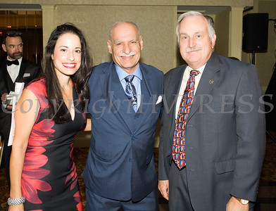 Gisela Gomez of M&T Bank, Latinos Unidos of the Hudson Valley President Peter Gonzalez, and Orange County Sheriff Carl DuBois pose for a photo during the Latinos Unidos 12th Annual Hispanic Heritage Cultural Celebration at Anthony's Pier 9 in New Windsor, NY on Friday, October 13, 2017. Hudson Valley Press/CHUCK STEWART, JR.