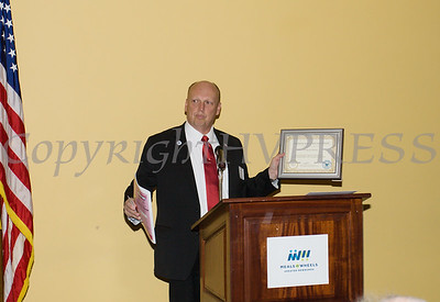 Town of Newburgh Deputy Supervisor Scott Manley makes a presentation to Meals on Wheels of Greater Newburgh who celebrated its 45th anniversary and its founder, Frederica Warner's 100th birthday on Sunday, November 19, 2017 at the Powelton Club in Newburgh, NY. Hudson Valley Press/CHUCK STEWART, JR.