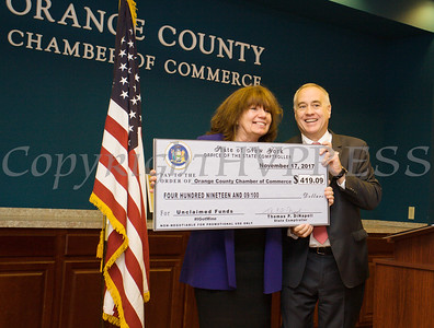 Orange County Chamber of Commerce President Lynn Cione accepts a check from New York State Comptroller Thomas DiNapoli after he addressed Chamber members on Friday, November 17, 2017 in Montgomery, NY. Hudson Valley Press/CHUCK STEWART, JR.