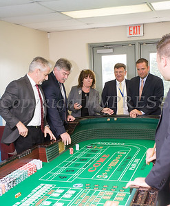 Orange County Chamber President & CEO Lynn Allen Cione rolls the dice following the ribbon cutting for the new Resorts World Catskills casino dealer school and educational center at Stewart International Airport in New Windsor, NY on Thursday, September 7, 2017. Hudson Valley Press/CHUCK STEWART, JR.