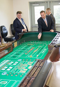 Stewart Airport General Manager Ed Harrison watches as Orange County Executive Steven Neuhau rolls the dice following the ribbon cutting ceremony for the new Resorts World Catskills casino dealer school and educational center at Stewart International Airport in New Windsor, NY on Thursday, September 7, 2017. Hudson Valley Press/CHUCK STEWART, JR.