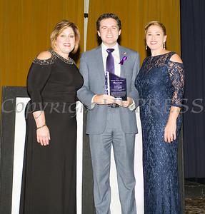 Anna Gibbs, left, and Kellyann Kostyal-Larrier, right, present New York State Assemblyman James Skoufis with the Family Justice Center Award as Safe Homes of Orange County celebrated its 31st Anniversary with a Celebration of Hope Masquerade Ball on Friday, October 20, 2017. Hudson Valley Press/CHUCK STEWART, JR.