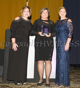 Anna Gibbs, left, and Kellyann Kostyal-Larrier, right, present Linda Muller, President and CEO of Cornerstone Family Healthcare with the Mildred Warren Good-Neighbor Award as Safe Homes of Orange County celebrated its 31st Anniversary with a Celebration of Hope Masquerade Ball on Friday, October 20, 2017. Hudson Valley Press/CHUCK STEWART, JR.