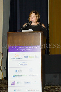 Anna Gibbs, Treasurer of the Board of Directors of Safe Homes of Orange County offers closing remarks as the organization celebrated its 31st Anniversary with a Celebration of Hope Masquerade Ball on Friday, October 20, 2017. Hudson Valley Press/CHUCK STEWART, JR.