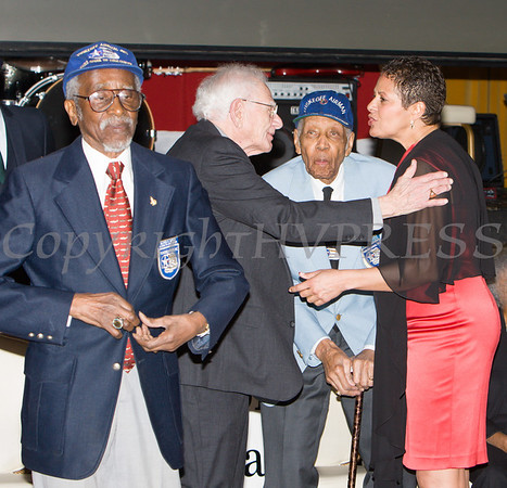 "Tuskegee Airmen Wilfred R. DeFour heads to his seat as B-17 navigator Harvey Horn and Tuskegee Airmen ""Coach"" Roscoe Draper talk with Anne Palmer during the 19th Annual Tuition Assistance Awards Celebration of the Major General Irene Trowell-Harris Chapter of the Tuskegee Airmen on Saturday, February 4, 2017 at Anthony's Pier 9 in New Windsor, NY. Hudson Valley Press/CHUCK STEWART, JR."