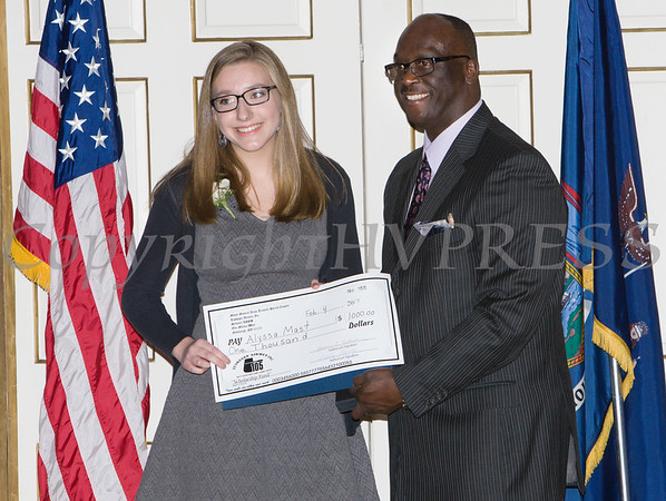 Award recipient Alyssa Mast receives an oversized check from Glendon Fraser during the 19th Annual Tuition Assistance Awards Celebration of the Major General Irene Trowell-Harris Chapter of the Tuskegee Airmen on Saturday, February 4, 2017 at Anthony's Pier 9 in New Windsor, NY. Hudson Valley Press/CHUCK STEWART, JR.