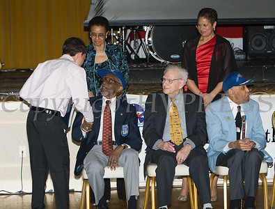 Award recipient Adelson Aguasvivas greets Tuskegee Airman Wilfred R. DeFour after receiving an oversized check from Glendon Fraser during the 19th Annual Tuition Assistance Awards Celebration of the Major General Irene Trowell-Harris Chapter of the Tuskegee Airmen on Saturday, February 4, 2017 at Anthony's Pier 9 in New Windsor, NY. Hudson Valley Press/CHUCK STEWART, JR.
