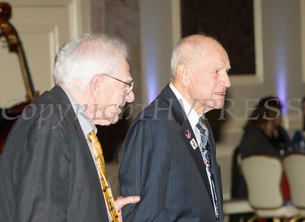 B-17 navigator Harvey Horn and NYS Senator William Larkin share a moment  during the 19th Annual Tuition Assistance Awards Celebration of the Major General Irene Trowell-Harris Chapter of the Tuskegee Airmen on Saturday, February 4, 2017 at Anthony's Pier 9 in New Windsor, NY. Hudson Valley Press/CHUCK STEWART, JR.